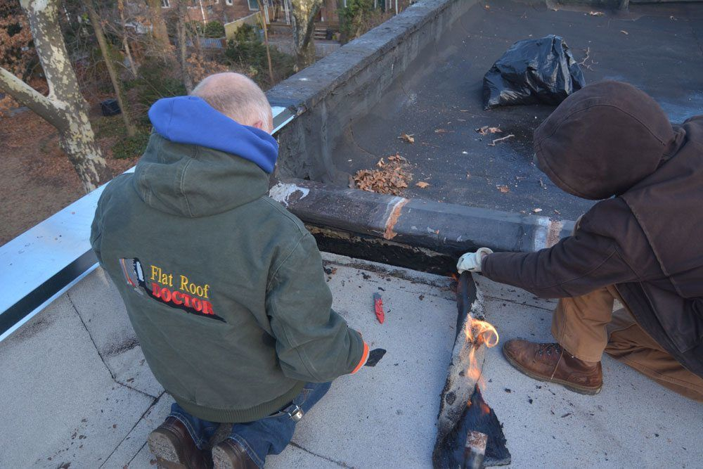 Patching flat roof with rubber membrane in Queens NY