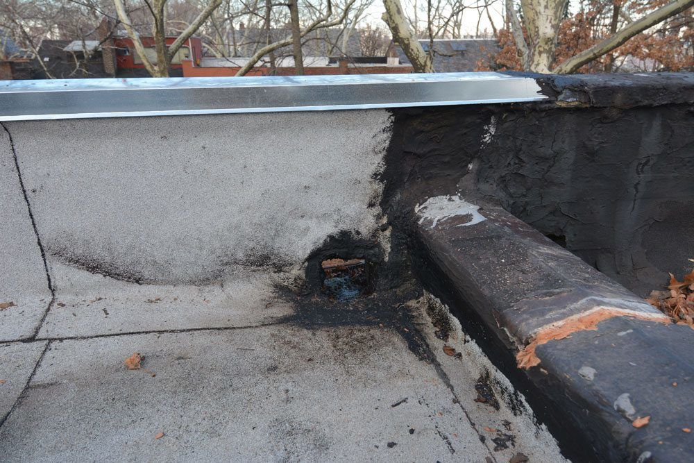 Scupper on Flat Roof Queens NY full of tar - Had to clean this mess up to make the necessary flat roof repairs