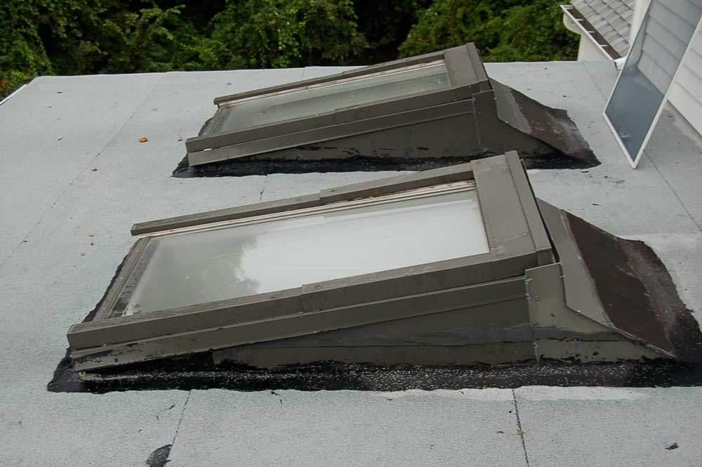 Skylight leak repair on a flat roof