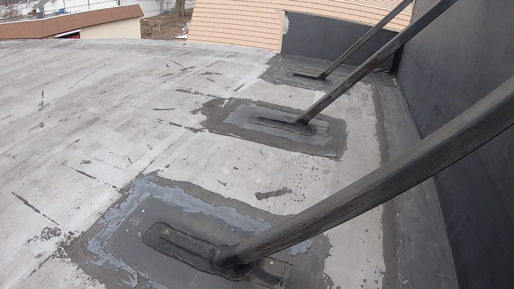 EPDM Rubber Transition to a Torch down rubber roof
