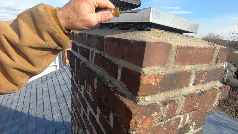 Flat roof leaks caused by chimneys