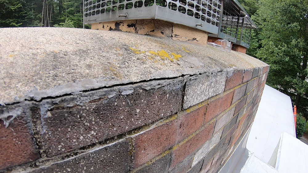 Cement slab on a chimney crown separating from chimney